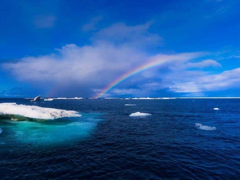 Rainbow over Arctic waters